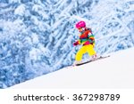 Child Skiing In Mountains....