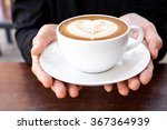 Hands Holding Cup Of Hot Coffe...