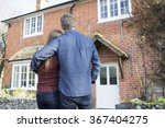 couple looking at their home  | Shutterstock . vector #367404275