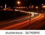 Night view of the lights of moving cars. - stock photo