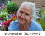 Happy Elderly Woman In Her...