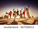 group of happy friends jumps on ... | Shutterstock . vector #367528511