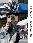 participant of pride parade in New York in gorgeous black and white costume - stock photo