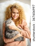 Stock photo young woman and cat lying on bed in the room 367606997