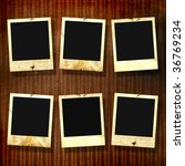 old photoframes are hanging on... | Shutterstock . vector #36769234