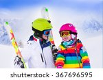 Boy And Girl Skiing In...
