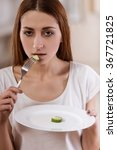 thin girl with an empty plate... | Shutterstock . vector #367721825