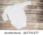 white baby bodysuit on wood | Shutterstock . vector #367731377