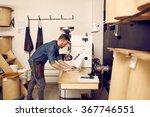 man using a laptop in modern... | Shutterstock . vector #367746551