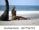 woman resting under a palm tree | Shutterstock . vector #367756751