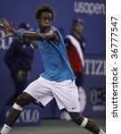 NEW YORK - SEPTEMBER 8: Gael Monfils of France returns a shot during 4th round match against Rafael Nadal of Spain at US Open on September 8, 2009 in New York - stock photo