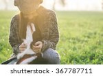 Stock photo young woman playing with her border collie dog concept about animals and people 367787711