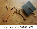 old key with education tag and