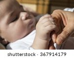 baby is holding  hand  | Shutterstock . vector #367914179