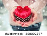 Female hands holding a gift box ...