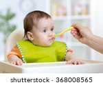 mother feeds funny baby from a... | Shutterstock . vector #368008565