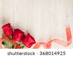 Red Roses On Wooden Background...