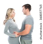 Small photo of Husband and pregnant wife hugging each other and fondle abdomen.