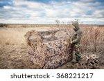 Man Installing Tent In Rural...