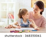 happy family. mother and... | Shutterstock . vector #368350061