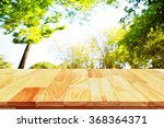 wood table top on shiny... | Shutterstock . vector #368364371