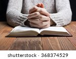 woman hands praying with a... | Shutterstock . vector #368374529