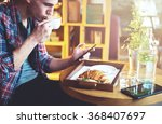 young man sitting at a cafe ... | Shutterstock . vector #368407697