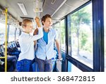 man and woman traveling by bus | Shutterstock . vector #368472815