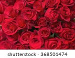 Stock vector red roses background in low poly style 368501474