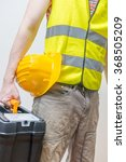 worker with toolbox and yellow... | Shutterstock . vector #368505209