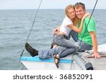 man and girl sits on the boad   Shutterstock . vector #36852091