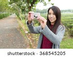 young woman taking a photo | Shutterstock . vector #368545205