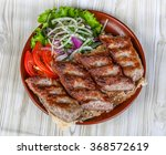 beef kebab with onion rings and ... | Shutterstock . vector #368572619