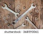 old tools on wooden background | Shutterstock . vector #368593061