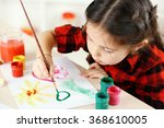 Cute Little Girl Painting...