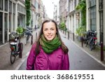 beautiful young woman walking... | Shutterstock . vector #368619551