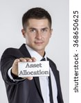 Small photo of Asset Allocation - Young businessman holding a white card with text - vertical image