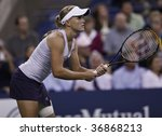 NEW YORK - SEPTEMBER 9: Melanie Oudin of USA returns a shot during quarterfinal round match against Caroline Wozniacki of Danmark at US Open on September 9 2009 in Flushing, New York. - stock photo