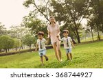asian family mom and two twins... | Shutterstock . vector #368744927