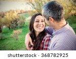 happy smiling couple in love | Shutterstock . vector #368782925