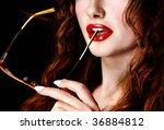 Businesswoman holding glasses - stock photo