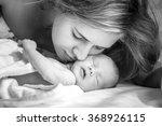 mother kisses her newborn baby .... | Shutterstock . vector #368926115