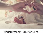 legs of a newborn baby. mom... | Shutterstock . vector #368928425