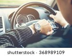 man driving a car and looking... | Shutterstock . vector #368989109