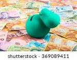 Piggy Bank On Dollar Bills In...