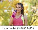 young beautiful woman drinking... | Shutterstock . vector #369144119