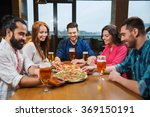 friends eating pizza with beer... | Shutterstock . vector #369150191