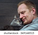Portrait Of A Man With A Cat....