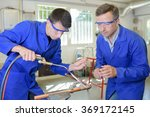 man overseeing trainee working... | Shutterstock . vector #369172145