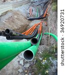 Plastic pipes in a ditch - stock photo